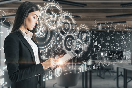 Businesswoman with tablet standing in modern office with abstract business cogwheel sketch. Success and technology concept. 3D Rendering Reklamní fotografie