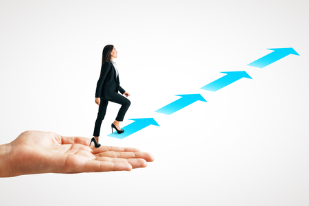 Side view of businesswoman with hand climbing arrow ladder on white background. Teamwork and growth concept