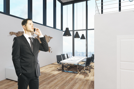 European businessman standing in modern office interior with panoramic sky view. 3D Rendering Stock Photo