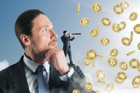 Abstract image of businessmen looking at bitcoin rain with binoculars. Research and cryptocurrency concept Archivio Fotografico - 112735705