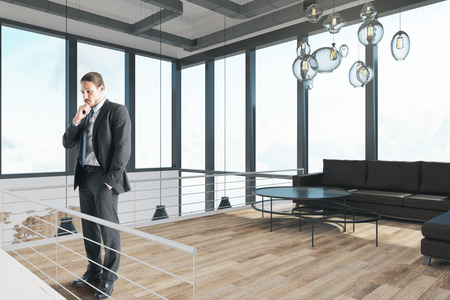 Handsome businessman standing in modern office interior with panoramic sky view. 3D Rendering Stock Photo