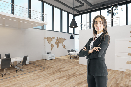 Attractive businesswoman standing in modern office interior with panoramic sky view. 3D Rendering Stock Photo