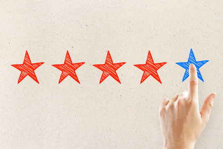 Hands with five star rating on light background. Ranking and exellence concept Stock Photo