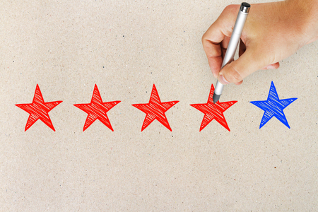 Hands with five star rating on light background. Ranking and leadership concept