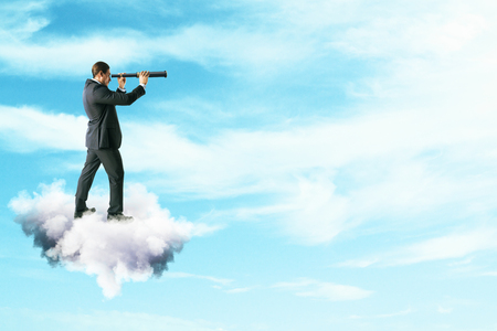Side view of young businessman on cloud using telescope to look into the distance on bright blue sky background. Vision and career concept