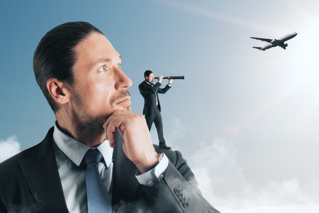 Businessman looking at airplane with telescope. Research and freedom concept
