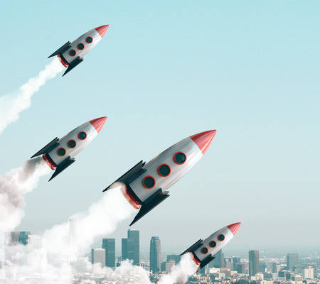 Launching rockets on city sky background. Startup and project concept. 3D Rendering