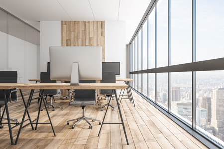 Modern wooden office interior with panoramic city view, equipment and daylight. Coworking workplace concept. 3D Rendering