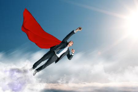 Flying businessman hero on sky background. Success and leadership concept
