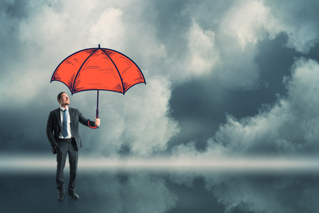 Young businessman holding drawn red umbrella on cloudy sky background. Protection concept 스톡 콘텐츠
