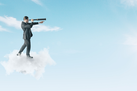 Businessman on cloud looking into the distance with binoculars on sky background. Vision and research concept