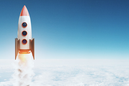 Launching rocket on blue sky background with clouds and copy space. Startup and success concept. 3D Rendering Фото со стока - 113936650