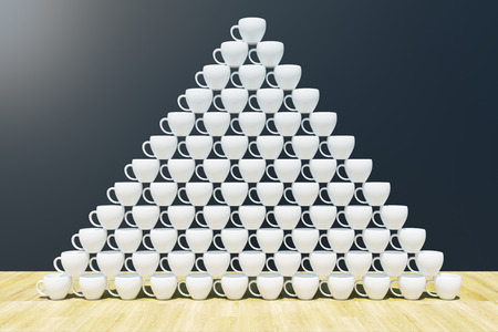 Coffee cup pyramid. Morning beverage and creativity concept. 3D Rendering