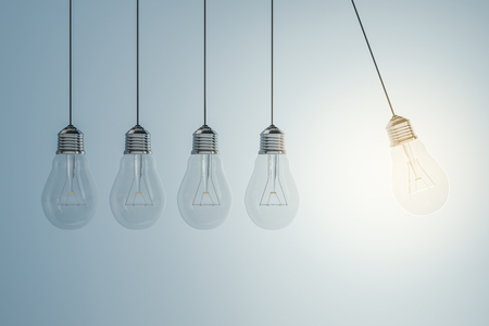 Low of light bulbs on light background. Idea and bright concept. 3D Rendering Reklamní fotografie