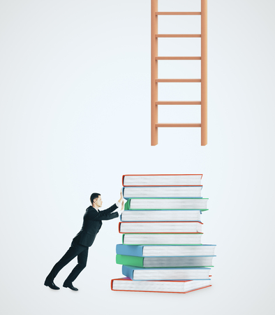 Businessman with piled books trying to reach ladder on white background. Growth and education concept