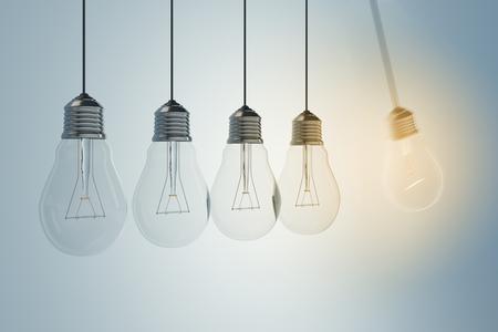 Low of light bulbs on light background. Idea and achievement concept. 3D Rendering Reklamní fotografie