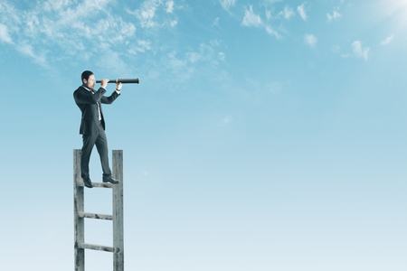 Businessman looking into the distance on ladder. Sky background with copy space. Forecast and future concept Archivio Fotografico - 114608607