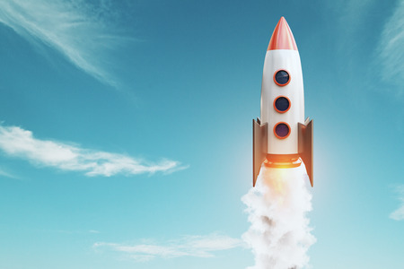 Launching rocket on blue sky background. Startup and project concept. 3D Rendering Stock Photo