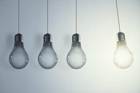 Glowing lamp row on concrete wall background. Idea and power concept. 3D Rendering Stok Fotoğraf