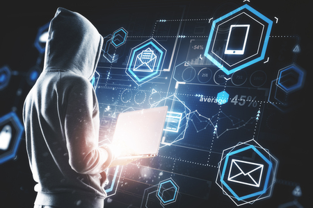 Hacker using laptop with digital business interface. Hacking, future and information concept. Double exposure 版權商用圖片