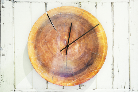 Close up of stylish round wooden clock. Design concept. 3D Rendering