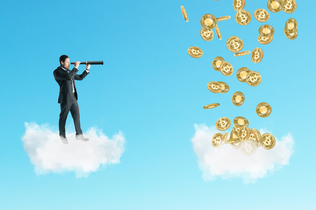 Young businessman on cloud looking at bitcoins with telescope. Forecast and cryptocurrency concept Archivio Fotografico - 115434259