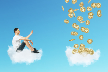 Side view of young businessman on cloud looking at bitcoins. Cryptocurrency and finance concept Archivio Fotografico - 115537666