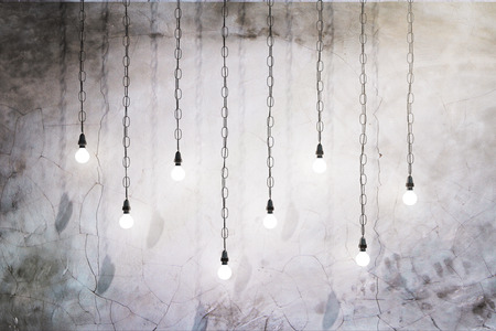 Creative lightbulbs on concrete wall background. 3D Rendering Stock Photo