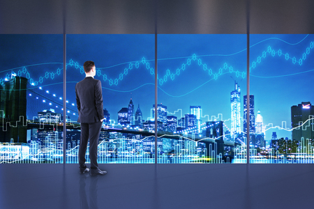 Trade and economy concept. Businessman in interior with night NYC view and forex chart. Double exposure