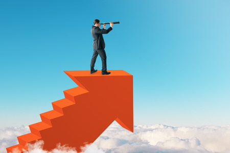 Young businessman on top of abstract red arrow ladder on sky background. Career promotion and research concept. 版權商用圖片 - 116137927