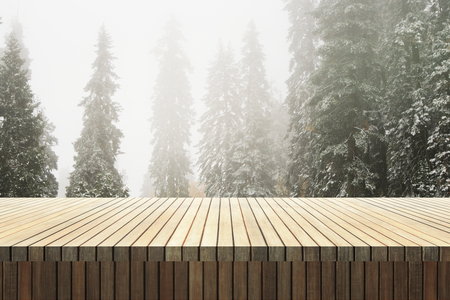 Empty wooden counter on forest background. Montage and picnic concept