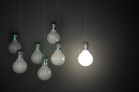 Glowing lamps on concrete wall background. Idea and innovation concept. 3D Rendering