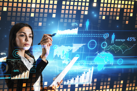 Attractive young businesswoman using digital business interface. Innovation and finance concept. Double exposure