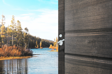 Opening wooden door with creative lake view. Holiday concept. 3D Rendering