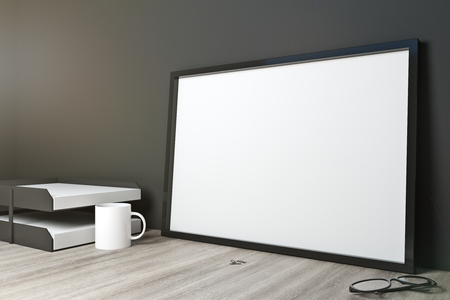 Empty frame on office desktop with supplies, coffee cup and concrete wall background. Mock up, 3D Rendering