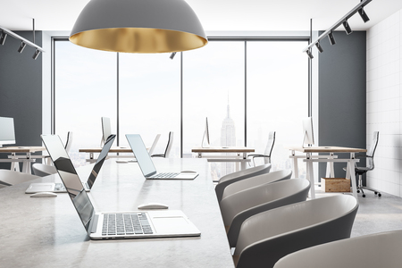 White coworking office interior with panoramic New York city view and daylight. 3D Rendering