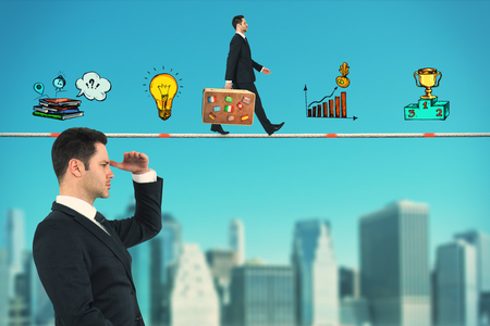 Side view of young businessman looking into the distance on abstract blue sky and blurry city background with business drawing. Research and success concept Stock Photo