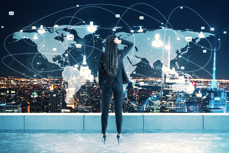 Back view of young woman looking at map on rooftop with night new york city background. Global business and network concept. Double exposure