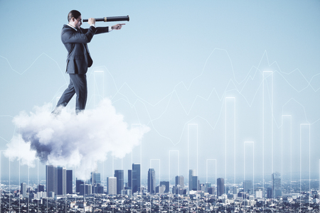 Businessman on cloud and city background with glowing chart looking into the distance with telescope. Vision and finance concept