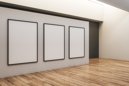Modern concrete exhibition hall interior with empty canvas and wooden floor. Gallery and museum concept. Mock up, 3D Rendering 写真素材