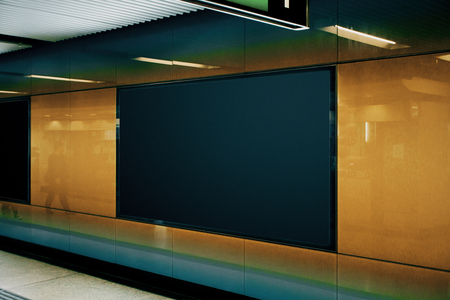 Side view of empty black subway poster on orange wall. Advertisement and urban concept. Mock up Banque d'images - 116673668
