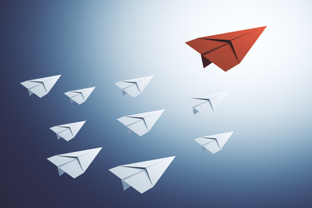 Creative paper planes on blue background. Leadership and follow concept. 3D Rendering