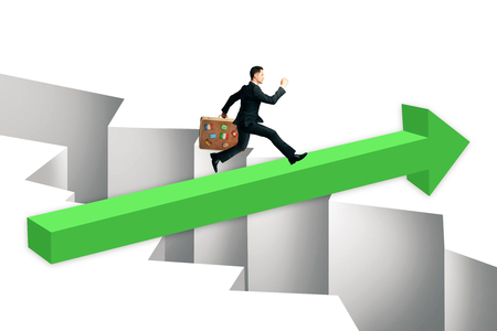 Businessman with travel suitcase running on green arrow over gap. Challenge and overcoming problems concept.