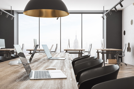 Contemporary coworking office interior with panoramic New York city view and daylight. 3D Rendering