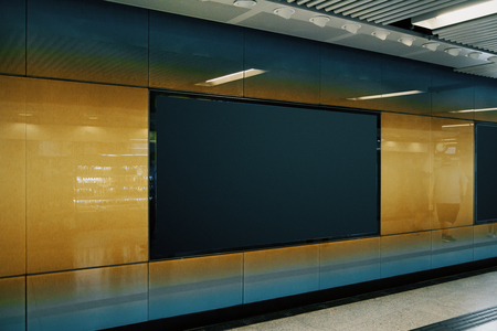 Side view of clean black subway poster on orange wall. Advertisement and urban concept. Mock up