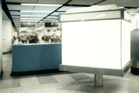 Empty white ad billboard in metro. Urban commercial and advertisement concept. Mock up Stock Photo