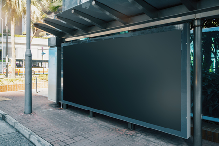 Side view of empty black horizontal billboard at bus stop. Commercial concept. Mock up
