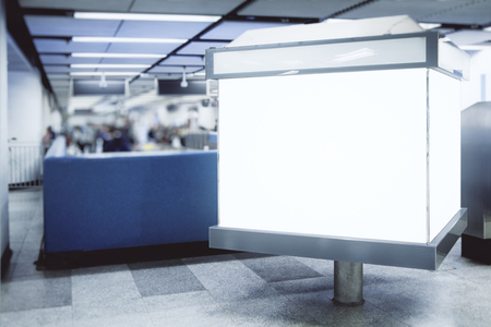 Empty white ad poster in metro. Urban commercial and advertisement concept. Mock up
