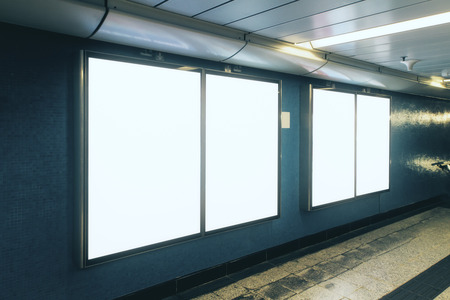 Side view of empty white subway poster on gray wall. Advertisement and urban concept. Mock up
