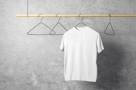 Empty one white tshirt on hanger. Concrete wall background. Design, store and style concept. Mock up, 3D Rendering